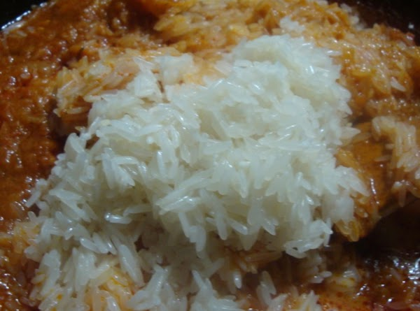 pour the rice into the tomato sauce over low heat and cover saucepan with...