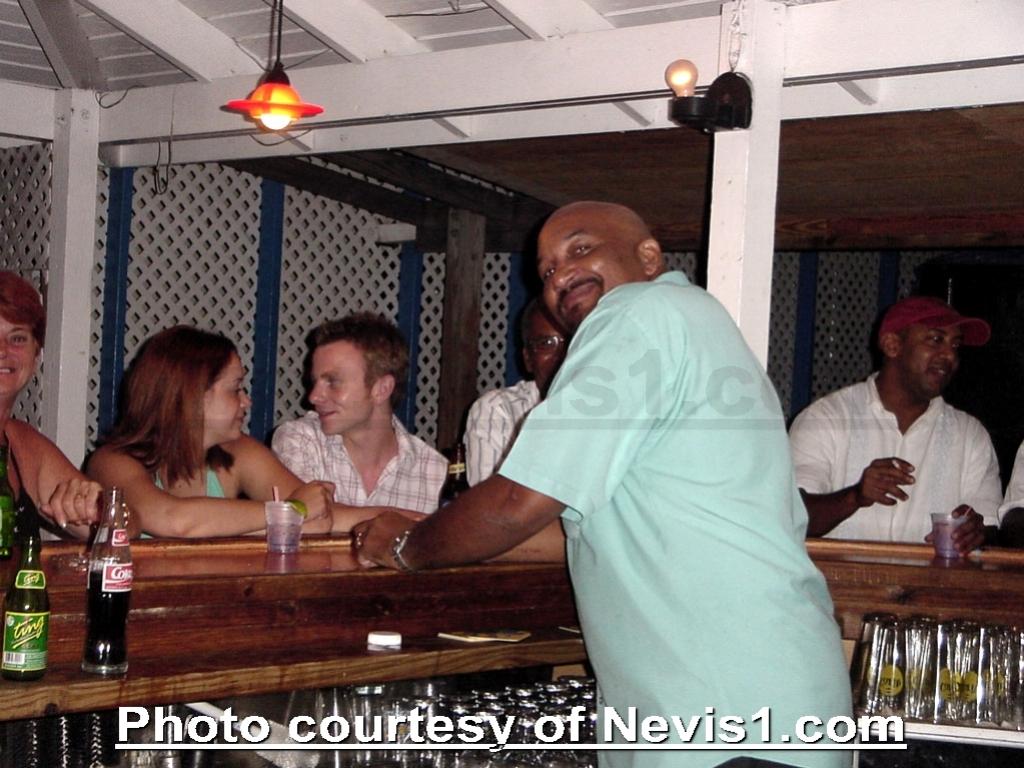 Photo: Eddy of Eddy's Bar and Grill - Charlestown, Nevis. http://nevis1.com/eddys-bar.html