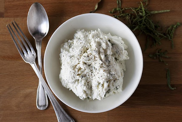 While beet is roasting prepare tarragon spread. Mix together the goat cheese,lemon juice,tarragon, lemon zest...