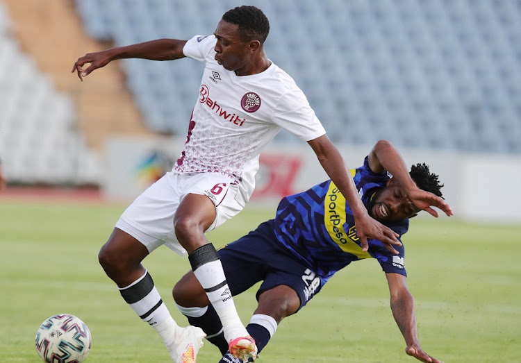 Tlakusani Mthethwa of Swallows challenged by Mduduzi Mdantsane of Cape Town City during the DStv Premiership match between Swallows and Cape Town City at Volkswagen Dobsonville Stadium on January 05, 2021 in Johannesburg, South Africa.