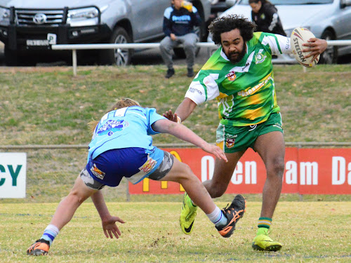 Boggabri under-18s player Rylan Simms fends off an attempted tackle by Narrabri's Kaleb McMillan on Saturday in Boggabri's 26-20 elimination semi-final victory at Kitchener Park, Gunnedah. Photos: Sue Haire