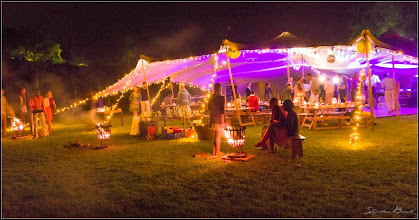 Photo: Celebration on the wedding meadow at night