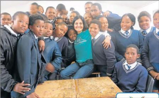 VISIONARY: Terisita Ndibongo posing with Grade 8 pupils from Mdibaniso Senior Secondary School. Picture: QAQAMBA MAGADLA