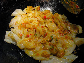 Photo: stir-frying cuttlefish with chilli paste