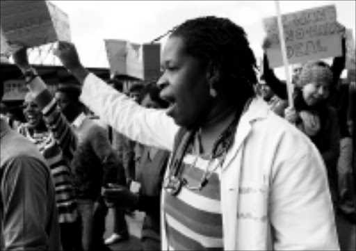 FED UP: Medical doctors protest over poor pay and bad working conditions in government hospitals outside Chris Hani-Baragwanath Hospital in Soweto. 22/05/09. Pic. Kevin Sutherland. © Unknown.