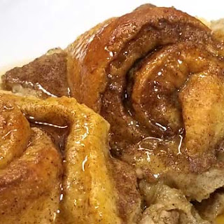 Cinnamon Roll Eggnog French Toast with Vanilla Bourbon Syrup.