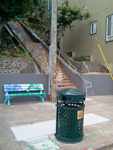 Photo: Our San Francisco Street Parks Program colleagues have made it a bit easier to keep the Hidden Garden Steps clean: a new garbage can is now in place at the foot of the Steps (16th Avenue, at Kirkham, in San Francisco's Inner Sunset District).  Jerad Weiner, Community Liaison, Community Programs with the San Francisco Department of Public Works, helped coordinate the effort to obtain and place the can in an area that has been subject to accumulations of paper cups, empty pizza boxes, and other litter left by visitors to the site. The availability of the trash receptacle has noticeably reduced the amount of onsite litter.  For more information about the gardens and the 148-step ceramic-tile mosaic completed by project artists Aileen Barr and Colette Crutcher, please visit our website (http://hiddengardensteps.org), view links about the project from our Scoopit! site (http://www.scoop.it/t/hidden-garden-steps), or follow our social media presence on Twitter (https://twitter.com/GardenSteps), Facebook (https://www.facebook.com/pages/Hidden-Garden-Steps/288064457924739) and many others.