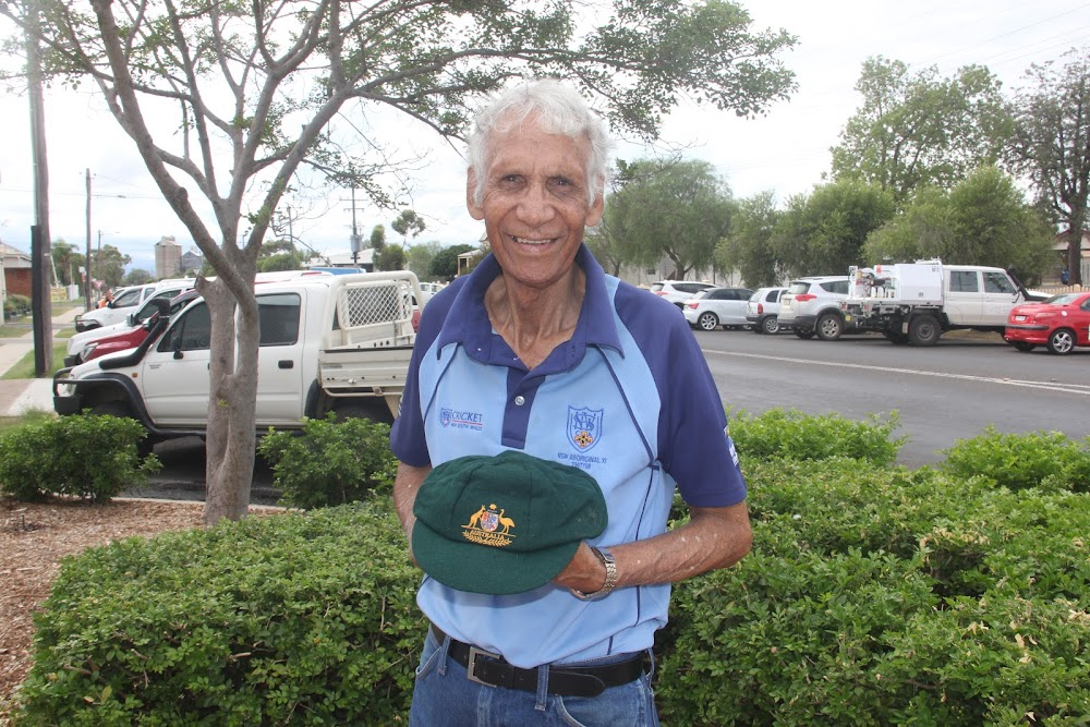 Les Knox proudly holds his baggy green, which he wore during a tour of England in 1988.
