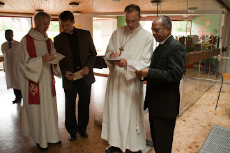 Photo: Gijsbertus van Hattem, Evangelical Lutheran Church in Belgium (ELKB) president, Rev. Brent Smith, regional director of Eurasia, LCMS International, Pastor Tepper and Pastor Raharijaonarivelo discuss the service.