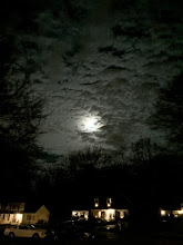 Photo: The Christmas full moon hides behind the clouds...