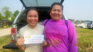Photo: Mayuree and mum receiving scholarship