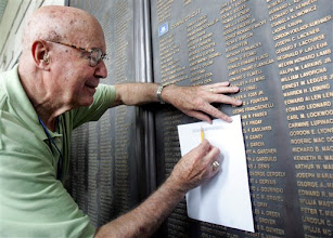 Photo: American Korean War veteran Don Edwards from Tucson, Arizona, copies the name of his colleague, Donald John Cunha, killed during the Korean War at Korea War Memorial Museum in Seoul, Sunday, June 24, 2007. South Korea has invited 88 foreign veterans to a ceremony, marking the 57th anniversary of the outbreak of a three-year war which began on June 25 in 1950. The United States and 15 other countries fought alongside South Korea under the U.N. flag against North Korean and Chinese troops.(AP Photo/Ahn Young-joon)