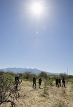 Photo: A hot morning sun beats down as a group of U.S. bishops walks the Arizona desert about 30 miles north of Nogales March 31. Nine bishops took part in a two-day tour focused on border issues in Nogales. They used the opportunity to again appeal for changes in the U.S. immigration system. (CNS photo/Nancy Wiechec) (April 1, 2014)