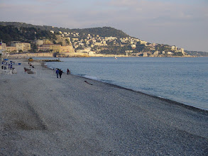 Photo: Late afternoon along the beach, looking east towards the buildings on Mont Boron.