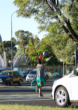 Photo: Final stop: Buenos Aires. A street performer is in the middle of the intersection