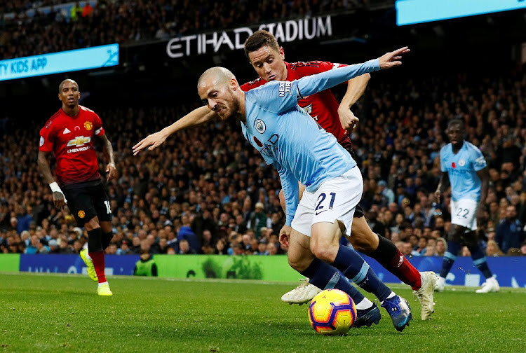 Manchester City's David Silva in action with Manchester United's Ander Herrera at Etihad Stadium, Manchester, Britain, November 11 2018. Picture: REUTERS/JASON CAIRNDUFF