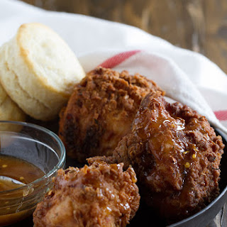Honey Fried Chicken with Hot Honey Sauce and Biscuits.