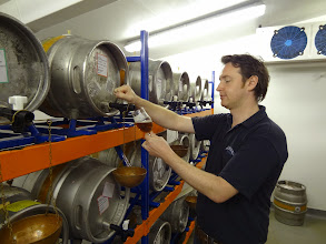 Photo: Adnams brewer Fergus Fitzgerald shares samples of real ales from the brewery's taste testing area.