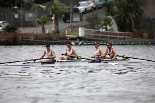 JOY OF VICTORY: Tuks' team members Sandro Torrente, David Hunt, John Smith and Kyle Schoonbee, were the winners of the men's coxless fours final, winning the prestigious solid silver Buffalo Challenge trophy at the annual Buffalo Regatta in East London on Saturday Picture: MARK ANDREWS