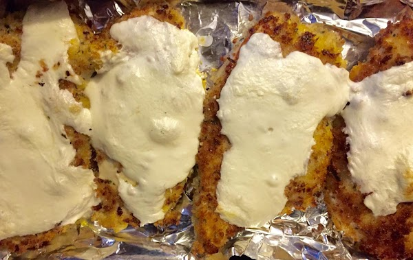 Place chicken in baking dish or pan. Top each piece with fresh mozzarella. Place...