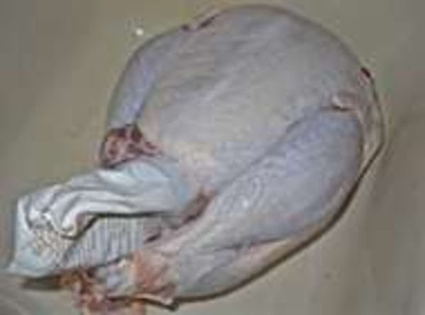 Remove Plactic turkey is sealed in.Remove pkg inserted in the cavity of the Turkey.(usually...