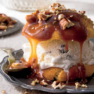 Decadent Cream Puffs with Praline Sauce and Toasted Pecans.