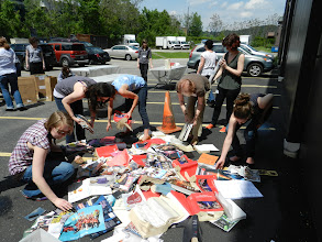 Photo: A few people from each group come to the pile to select damaged materials.