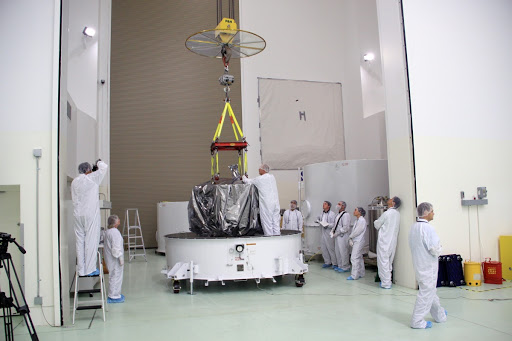 Applied Physics Laboratory technicians prepare to lift NASA's Radiation Belt Storm Probe A wrapped in a shroud from the bottom of its shipping container.
