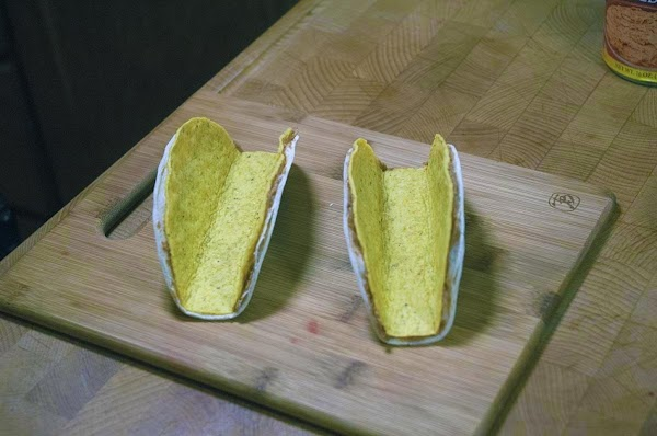 Remove the taco shells from the oven.