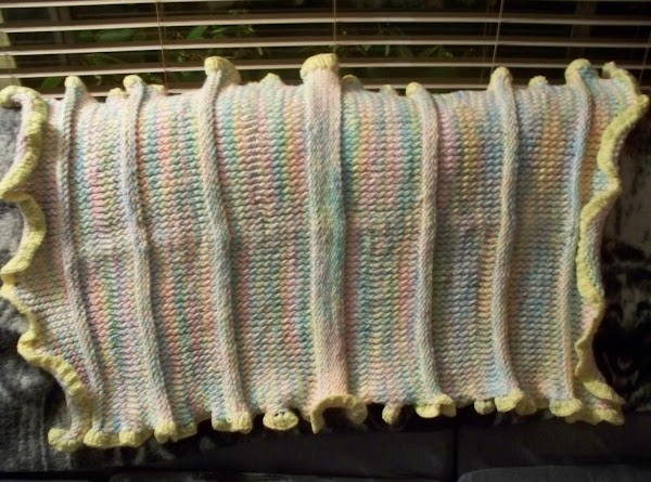 A baby blanket that I made on a long loom. I used the e...