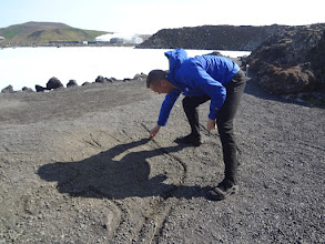 Photo: I got a private tour where my guide Jonni explained all about Iceland - here he's drawing a map of the country