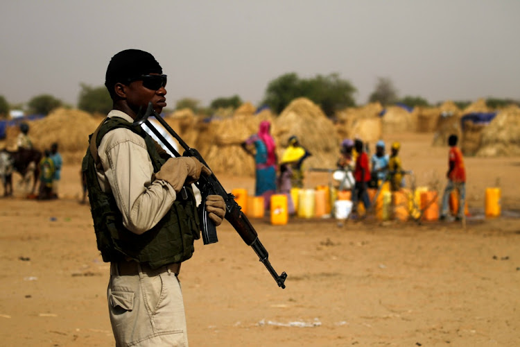 A Nigerien soldier stands guard at a camp of refugees fleeing Boko Haram fighters. Picture: REUTERS/Luc Gnago
