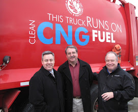 Photo: Troy Ferguson of Congressman Walden's office, Wendel Smith of Rogue Disposal and Recycling and Bill Maentz of FiveOClock Marketing admire one of the first CNG waste trucks in Oregon.