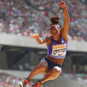 Going for the gold.  by Ron Russell - Sports & Fitness Running ( grace, flight, athletics, jumping, female, action, running )
