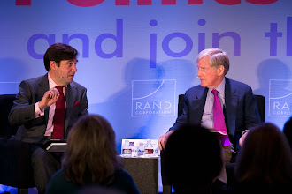 """Photo: Rob Cox asks Robert Wilmers a question during the """"Financial Regulation: Fixing Too Big to Fail"""" panel discussion Friday, Nov. 16, 2012 at the RAND Politics Aside event in Santa Monica, Calif."""
