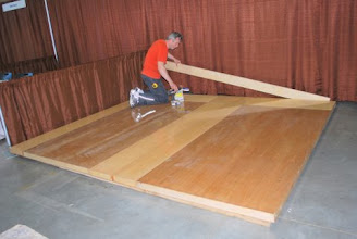 Photo: Installing a torsion box sandwich core trade show floor is easy with our large lightweight panels. Cover the ends with a 2x6 Sing Beam to connect the wall and floor.