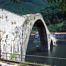 Photo: Ponte della Maddalena also known as Ponte del Diavolo (the Bridge of the Devil) for +BridgesOverTuesday and +#BridgesAroundTheWorld.  I saw this bridge again months ago in a post by +Andrea Federici: https://plus.google.com/u/0/101832053372535369591/posts/AxSTWdEGntU   This photo is a scan of a picture taken 1995. My wife Chris is the person on top of the bridge.
