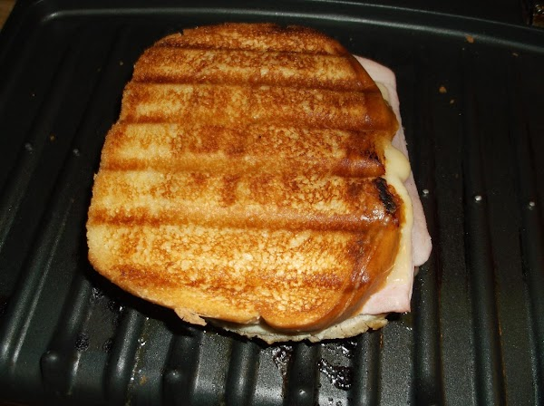 Flip and rotate sandwich 1/2 turn after 1 1/2 to 2 minutes; grill an...