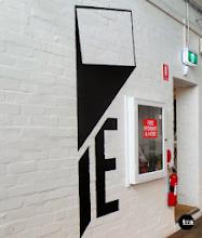 Photo: Traditional Signwriting (6 photos) Visual Process of signwriting IE Media's logo to a painted white brick wall. #signwritten #signwriting #logo #IEMedia