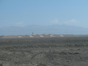 Photo: In the distance are the Flaming Mountains. This area gets intensely hot in the summer, and the mountains turn a flaming red color. It was 43 degrees Celsius on the day I visited!