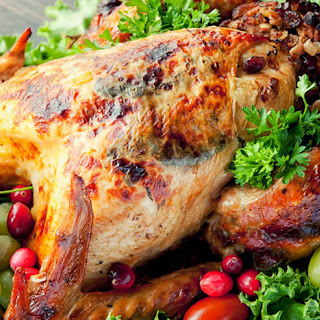 Herb-Crusted Turkey With Apple-cranberry And Veal Stuffing Recipe.