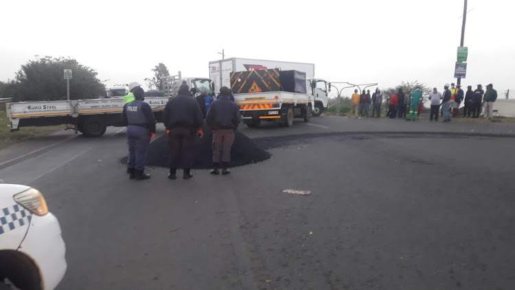 Trucks blockaded roads in Verulam on the M27 as widespread protest action began in Durban early on Friday morning.