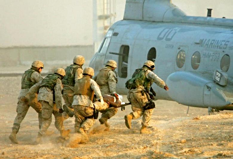 US soldiers carry an injured colleague to a helicopter near the city of Falluja, Iraq, in this November 10 2004 file photo. Picture: REUTERS/ELIANA APONTE