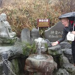 visiting a shrine in pooring rain weather in hakone in Hakone, Kanagawa, Japan