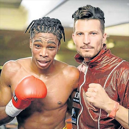 RED-HOT: Mdantsane-born Thulani Mbenge with trainer Sean Smith. Mbenge notched up his ninth straight win by stoppage this past weekend Picture: SUPPLIED