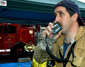 Photo: Norm Cummings SPECTRUM/Jim Reilly of Sherman firefighters helps direct a Jan. 13, 2007 drill at Mill Pond