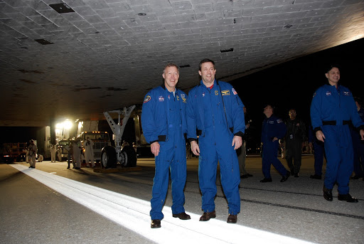 Dominic Gorie and Mission Specialist Mike Foreman pose for a portrait under Endeavour at NASA Kennedy Space Center's Shuttle Landing Facility.
