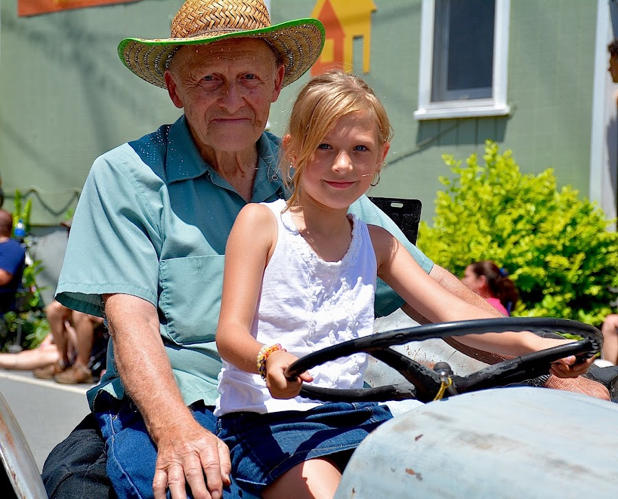PROUD GRANDPA by Doug Hilson - People Family ( parade, girl, grandfather, cute, tractor,  )