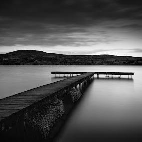 Lough Derg fishing Stand by John Holmes - Black & White Landscapes ( water, hills, monochrome, fishing beats, ireland, wood, black and white, clare, long exposure, lake, lough, derg, killaloe )