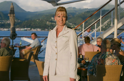 amanda-millar-in-st-lucia.jpg -  Amanda Millar, guest services director, at sunset on the aft deck of Wind Surf with St. Barts in the background.